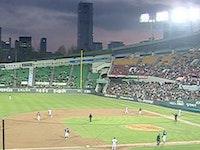 Triathletes take in a baseball game in Seoul